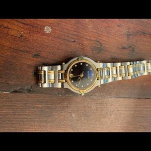 Vintage Gucci gold/silver/diamond watch